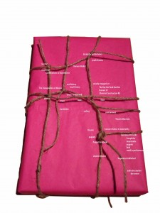 parcel wrapped in tissue and string with captions relating to themes of work: poetry, theatre, smell, medicine, walks etc