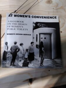 Cover of book At Women's Convenience with black and white photo montage of women queuing outside a 'Superloo'